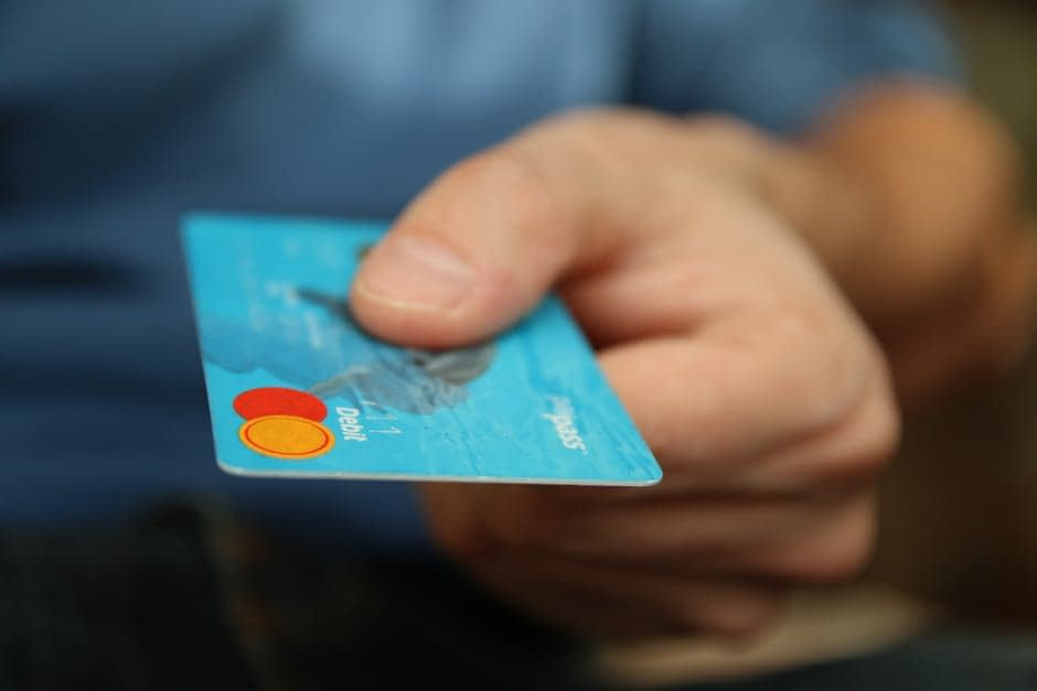 holding a credit card